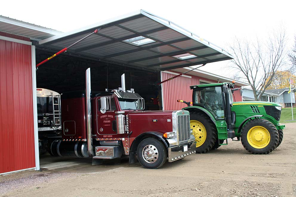 A machine shed storing Semi-Trucks and Tractors