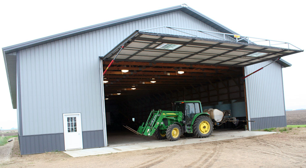 tractor inside building with open hyrdraulic door